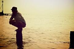 Stranded (FionaMillsArt) Tags: sky sun beach water silhouette sparkles golden pier westsussex sparkle ripples groyne shimmer bognorregis groynes