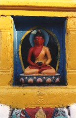 Statue of a red Buddha holding a begging bowl, blue and yellow aura, pink, orange, and blue lotus, stupa niche, vajra, Swayambhunath, Kathmandu, Nepal (Wonderlane) Tags: pink blue nepal red orange yellow statue religious holding buddha culture halo bowl kathmandu aura begging vajra swayambhunath tibetanbuddhist statueofaredbuddhaholdingabeggingbowl blueandyellowaura pinkandbluelotus stupaniche buddhaholdingabeggingbowl andbluelotus