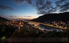 Heidelberg - Glowing (Andy Brandl - www.PhotonMix.com) Tags: trees sky mountains night clouds germany nikon cityscape churches cathedrals heidelberg altstadt d800 badenwuerttemberg neckarriver altebrckeheidelberg photonmix elevatedpov laoanphotography hauptstraseheidelberg