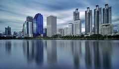 City with skyscrapers with reflection in the lake. (Samart Boonyang) Tags: park city urban reflection building architecture modern skyscraper river landscape thailand town office asia downtown cityscape waterfront bangkok midtown reflect condominium