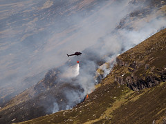 04_05_2011_0401 (andysuttonphotography) Tags: wild mountain water fire scotland highlands heather smoke flames scottish dry aerial smoking helicopter burning burnt cul blaze wilderness firefighting mor wildfire heatwave extinguish extinguishing blackened assynt drenching dousing