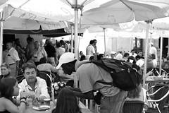 Cada uno se gana la vida como puede. (...Away...) Tags: summer people woman man hot work spain restaurants childrens sanlucardebarrameda