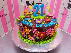 Bright mixed coloured garden scene on ganache icing (Charly's Bakery) Tags: daisies garden 21st butterflies