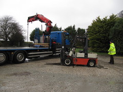 The low loader had a very heavy duty crane (wallygrom) Tags: england storm flooding nissan westsussex floods forklift angmering nissanforklift manornursery manornurseries {vision}:{outdoor}=0985
