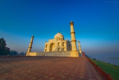 Courtyard perspective, Taj Mahal (Soma Images) Tags: world sun india man tower art heritage stone architecture sunrise wonder temple dawn golden persian site spires delhi indian muslim famous towers taj tajmahal ag