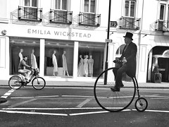 Two wheels from two eras (Rob Pearson-Wright) Tags: candid bicycle penny farthing bw blackandwhite iphone shotoniphone7 mobilephotography london uk old new street streetphotography
