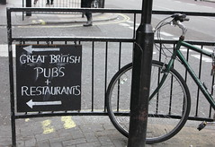 Great British pubs (mommaskill) Tags: street uk bw london bike sign mono restaurants pubs