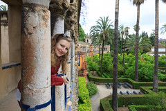 The princess of Real Alcazar de Sevilla (feradz) Tags: portrait woman nature beautiful garden sevilla spain pretty palace tourist seville andalucia blond palmtree tropical alcazar charming andalusia youngwoman galya realalcazar royalalcazargardens