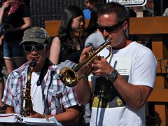 Play That Jazz (dons projects) Tags: city sunlight canada sunshine sunglasses june vancouver pen bc candid trumpet sunny streetscene olympus canadian celebration saxaphone streetperformer eastside sax brass olympuspen sonnig sonne commercialdrive zuiko vancouverbc eastvan eastvancouver thedrive m43 zd mft fourthirds 2013 italianday 1442mm photoscape seeninvancouver epl1 microfourthirds 43 mzuiko m1442 m1442mm olympuspenepl1 donsprojects