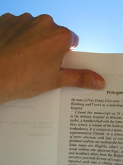Summer reading (Boganis) Tags: sunshine reading book holding edinburgh hand text bluesky