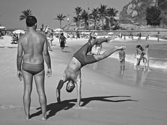 A Boy having fun at the Arpoador Beach (alobos Life) Tags: boy sea brazil sun playing man cute male sol beach water beautiful rio brasil de fun outdoors mar sand agua janeiro action body candid sony garoto enjoy brazilian alegria chico having garotos enjoying jugando arpoador divertido nex5r