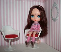 I got my Blythes the same chairs that I have in my apartment. Even matching cushions! Mini Tulip Chairs!!!!!