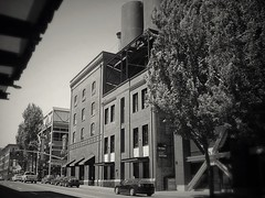 Brewery Complex (TMimages PDX) Tags: city urban usa building geotagged photography photo downtown cityscape unitedstates image streetscene explore photograph portlandoregon romanesque fineartphotography publicspaces historicplaces flickrexplore explored brewerycomplex iphoneography henryweinhardsbrewerycomplex