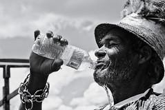 Thirsty (fcribari) Tags: 2017 56mm bw brasil brazil fujifilm nazaredamata pernambuco xpro2 blackandwhite carnaval carnival face folclore folklore hand hat maracatu maracaturural mineralwater monochrome pretoebranco water thirsty thirst