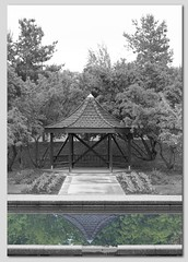 Gazebo reflection (GeniusSavant) Tags: bw reflection canon garden 50mm f14 gazebo pullman t3 selectivecolourisation