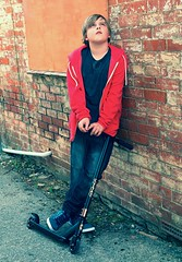 a boy and his scooter (slightly everything) Tags: uk light boy england brick childhood wall youth one hoodie europe style son scooter realpeople preeteen ©katehiscock
