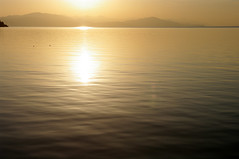 Sunrise at lake Sevan (Gregor  Samsa) Tags: morning light sun lake reflection water sunrise dawn illumination armenia armenian lich sevan lakesevan sevanalich   sevana