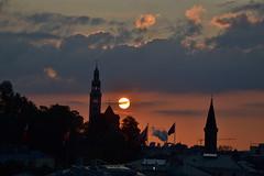 Sunset above Salzburg-Mülln - with a cloud in front of the sun (echumachenco) Tags: sunset sun salzburg church june juni clouds austria österreich sonnenuntergang kirche wolken sonne steinterrasse musictomyeyes mülln hotelstein nikond3100 rememberthatmomentlevel4 rememberthatmomentlevel1 rememberthatmomentlevel2 rememberthatmomentlevel3