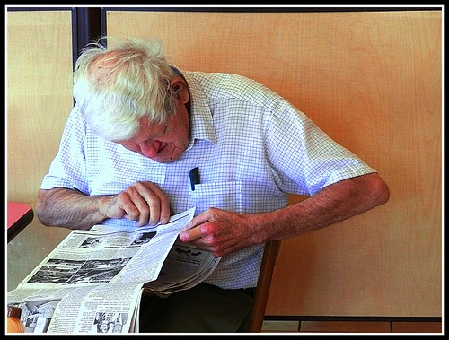 An Elderly Man Reading His Newspaper - Photo by STEVEN CHATEAUNEUF - September 28, 2013