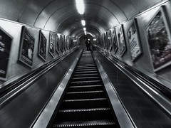 Follow Him (IngeniousImages) Tags: uk england bw blur london silhouette underground subway movement metro escalator tube steps tunnel follow gb uploaded:by=flickrmobile flickriosapp:filter=nofilter liverpoolstreetlondonundergroundstation vision:outdoor=0621 vision:car=0593