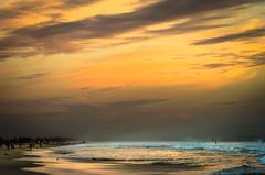 The winter swimmer (carogray1) Tags: ocean winter sunset sea mist seascape beach golden colours dusk santamonica dramatic santamonicabeach burnished beautifulsky winterbeachscene vision:sunset=0956 vision:sky=0978 vision:outdoor=0803 vision:ocean=0658 vision:clouds=0949 vision:car=0539 sunsetonsantamonicabeach skyskyandsky