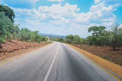 The road ahead, Zambia (ReinierVanOorsouw) Tags: africa road travel travelling clouds african roadtrip afrika asphalt zambia lusaka southernafrica travelphotography beyondborders sambia zambie travelafrica zmbia   zambi beyondbordersmedia