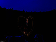 Marshmallow on fire (Mystikopoulos) Tags: wood longexposure camping light summer canada love night forest fire heart quebec outdoor coeur relationship f wife pontiac ncc truelove partner feu bois ete ccn guimauve sepaq mashmallow outdooring
