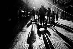 Segway (Gary Perlmutter Street Photography) Tags: holiday x70 fujifilm streetphotography monochrome segway helmet contrajour sunlight lisbon portugal cobbled perlmutter
