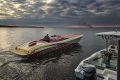 The Thunder of Herds of Horsepower (SteveFrazierPhotography.com) Tags: boat yacht motorboat watercraft powerboat speed speedboat powerful powerhouse bow sunset puntagorda fishermensvillage docked evening beautiful water waves shore shoreline condos condominiums light clouds cloudy overcast dramatic ray sunlight beams sunbeam stevefrazierphotography charlotteharbor peaceriver charlottecounty florida fl canoneos60d duterlinits 42legacy