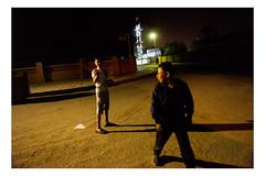 A local boy lights up a firecracker in a remote neighbourhood of Aqaba, Jordan. (Roman Lunin) Tags: jordan aqaba night arabworld arab firecracker reportage journalism children kids photojournalism documentary photodocumentary