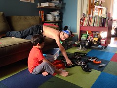 W & M Playing (davitydave) Tags: sf sanfrancisco boy shirtless male northerncalifornia toy starwars kid bedroom friend track child play son disney teen r2d2 barefoot rocket 4yo mickeymouseears 13yo hexbugs uploaded:by=flickrmobile flickriosapp:filter=nofilter
