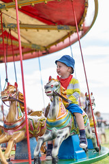 Riding the Carousel at the Chale Show - IMG_4173 (s0ulsurfing) Tags: boy summer portrait cute vintage fun happy toddler infant play faces head expressions content ears august carousel william isleofwight colourful chale infants funfair wight minime fofinho twoyearold countryshow 2013 s0ulsurfing familyuk chaleshow gettyimagesportraits