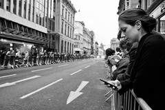 Waiting for the Runners (Leanne Boulton) Tags: life street city portrait people urban bw woman white black monochrome sport mobile race canon scotland blackwhite technology glasgow marathon candid crowd profile running scene human half
