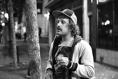 Frenchie (local paparazzi (isthmusportrait.com)) Tags: street autumn windows shadow portrait people blackandwhite bw hairy white man black cold detail reflection building male fall window glass hat shirt bar contrast hair beard french outdoors person persona pod lowlight hands long downtown branch darkness unique candid character grain longhair streetphotography stach smoking jacket portraiture figure noedit frenchie chilly shaggy neat usm madisonwi mustache noise statestreet scooby stubble hawks isthmus streetportraiture iso6400 2013 sooc 50mmf14usm straightoutofcamera danecountywisconsin photoshopelements7 canon5dmarkii pse7 localpaparazzi redskyrocketman lopaps