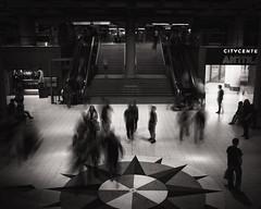 Alone in Crowd (Vesa Pihanurmi) Tags: longexposure people urban blackandwhite motion monochrome stairs movement helsinki interior citycenter