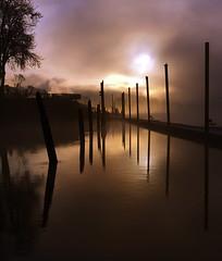 Dramatic Dawn (Darrell Wyatt) Tags: water clouds reflections dawn drama steamboatlanding
