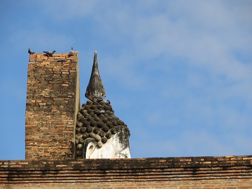 Sukhothai Buddha with birds - Thailand (ashabot) Tags: blue sky sculpture birds thailand buddha statues buddhism temples shrines sukhothai antiquities