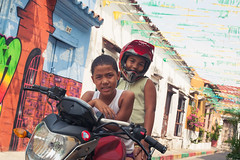 what's app? (blackeyeliner) Tags: boy playing latinamerica southamerica girl architecture children colombia sitting colonial bolivar motorbike spanish oldtown cartagena canoneos5d primelens getsemani canonef50mmf18ii