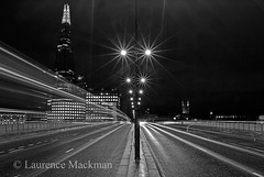 LondonBridge 033 E W BW (laurencemackman) Tags: lighting longexposure bridge england london tower cars glass architecture modern night reflections londonbridge concrete photography lights twilight traffic piers architect historical elevation architects shard riverthames renzopiano span streamline londonbridgestation londonskyline broadwaymalyan theshard motthayandanderson lordholford