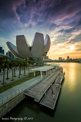 Intense Bloom (t3cnica) Tags: city sunset urban sun museum architecture marina bay landscapes singapore long exposure cbd sands mbs blending artscience