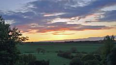 As the light fades away.... (littlestschnauzer) Tags: uk sunset sky sun west green rural landscape golden countryside nikon colours village view yorkshire horizon scenic farmland fields setting tones huddersfield emley d5000 elementsorganizer11