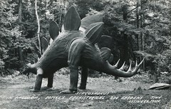 Domke's Prehistorical Zoo Gardens, Ossineke, Michigan (SwellMap) Tags: road tourism monument playground statue architecture vintage advertising design weird pc 60s highway fifties postcard suburbia style kitsch tourist retro nostalgia chrome freeway amusementpark americana rides 50s publicart unusual tacky roadside roadsideattraction googie populuxe themepark sixties touristattraction babyboomer consumer coldwar midcentury spaceage atomicage publicmonument