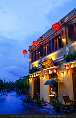 Hoi An, Vietnam riverside pubs (green678) Tags: sky reflection tree vertical architecture outdoors photography day flag tranquility symmetry vietnam hoian transportation distant colorimage buildingexterior thubonriver quangnamdanangprovince recreationalboat incidentalpeople gettychinaq4