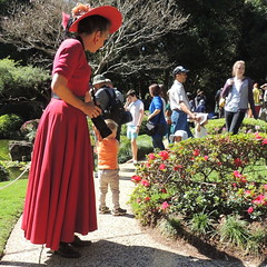 The Photographer (Grenzeloos1 - thanks for 5 million+ views!) Tags: camera flowers winter red people beautiful hat lady walking nikon photographer dress brisbane queensland japanesegardens toowong 2013 japanday mtcootthabotanicalgardens