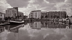 The calm after the festival (moggsterb) Tags: city sky urban bw reflection wet sepia clouds marina boats fred yachts hull p365 hullmarina humberstreet s95 p365348 s95365 p365mgb