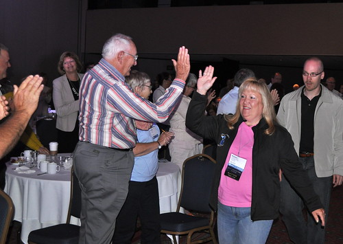 Ironwood City Leaders High Five Michigan Municipal League Members on the way to the Stage to Accept the 2013 Community Excellence Award