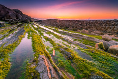 Green ways - [Explore-178] (Nov/3/13) (Juan C Ruiz) Tags: sunset espaa orange verde green spain puestadesol madero geology naranja rocas cantabria algas geologia cantabrico verdin liencres pielagos estratos somocuevas vision:mountain=0816 vision:sunset=0701 vision:o