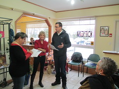 Monte gathers signatures on a petition to stop the trades tax at Accents Hair & Gift Studio in Grand Bend.