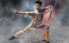 Hou Lin (Pierre Beteille) Tags: martialarts sabre kungfu sword wushu fighting combat artmartiaux vision:people=099 vision:face=099 vision:sky=0785 vision:clouds=0543 vision:outdoor=0918