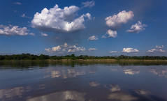 Clouds and Reflections (aldo_146) Tags: sky water clouds river amazon bolivia highlights amazonia beni watermirror riberalta